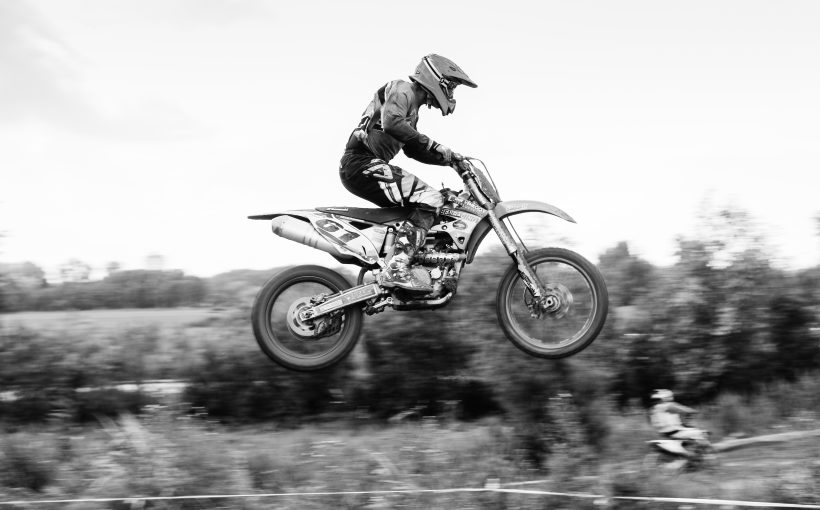 Motocross racer jumping high